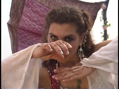A belly dancer wears traditional clothing and performs a belly dance Footage