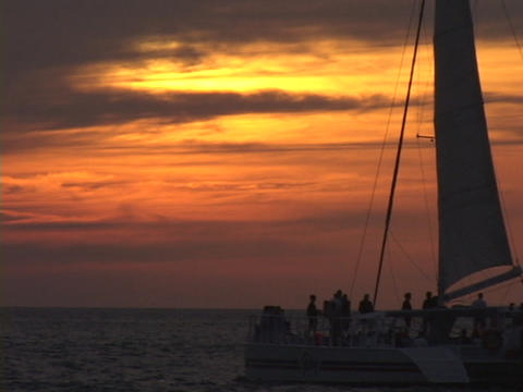 A large catamaran sailboat glides on ocean waters during... Stock Video Footage