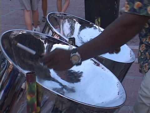 A Caribbean man plays a set of steel drums Stock Video Footage