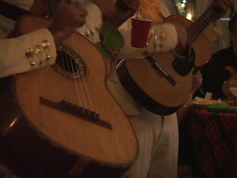 A mariachi band strums their rhythmic guitar music in a... Stock Video Footage