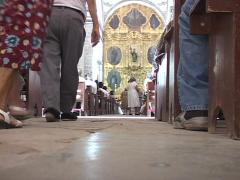 Congregates of a Mexican Catholic church walk to the... Stock Video Footage