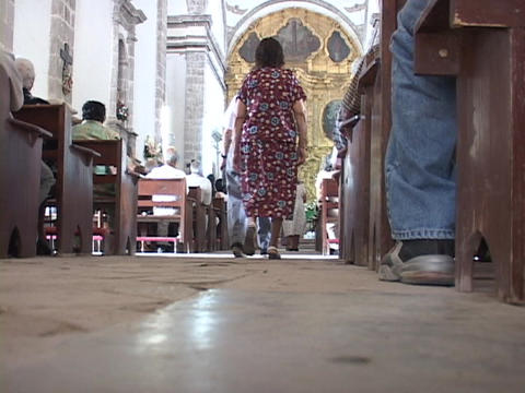 Congregates of a Mexican Catholic church walk to the front for prayer Footage