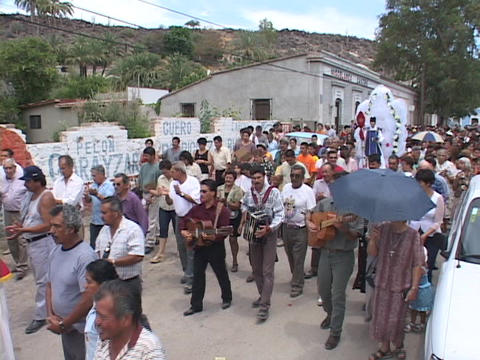 The occupants of a small Mexican village parade in a... Stock Video Footage