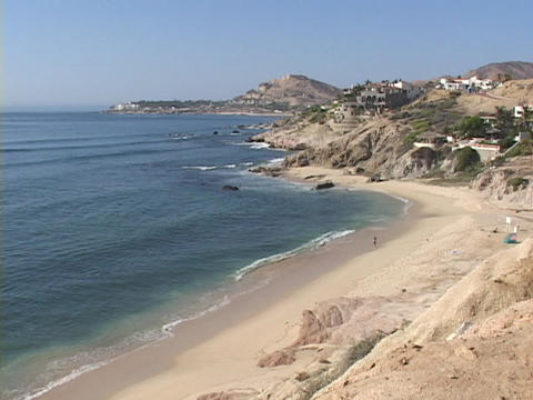 Very wealthy beach houses perch on the hills next to the... Stock Video Footage