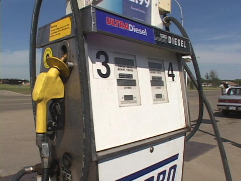 A Diesel fuel only gas pump rests in blue skies Live Action
