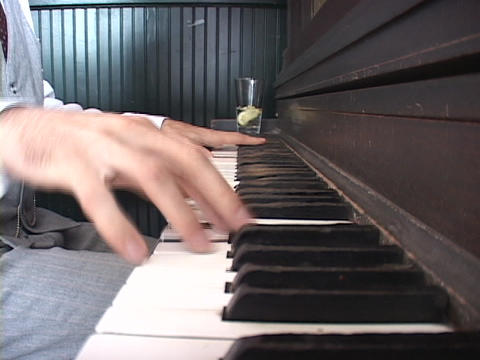 A man's hands dance across the keyboard of a ragtime piano Stock Video Footage