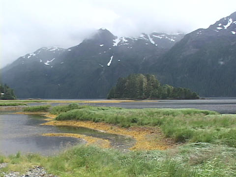 Mist hangs over the top of an Alaskan mountain range Stock Video Footage