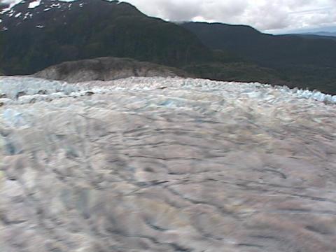 A colorful Alaskan glacier slips past Stock Video Footage