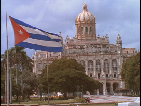 The Cuban flag waves outside the capital building in Cuba, Havana Footage