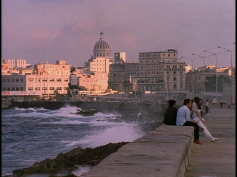 Cuban men sit at the waterfront in Havana Cuba during... Stock Video Footage