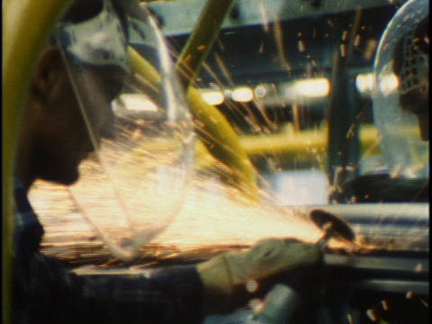 Workers work an assembly line in car factory Stock Video Footage