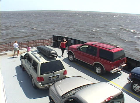 A family takes in the ocean view from the deck of a ferry Stock Video Footage