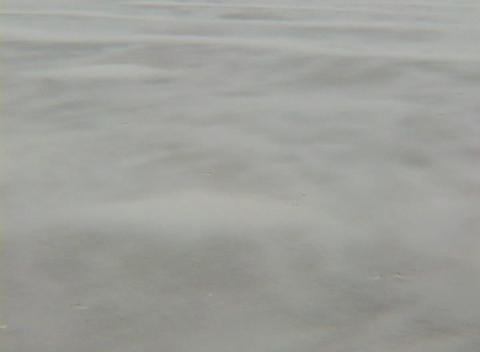 Dirt blows rapidly across the ground causing a constant... Stock Video Footage