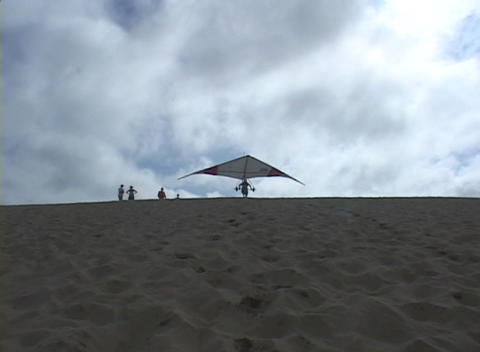 A hang-glider runs and flies out of sight after a... Stock Video Footage