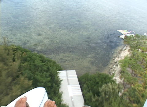 A pilot in an ultralight airplane lands in the ocean Stock Video Footage