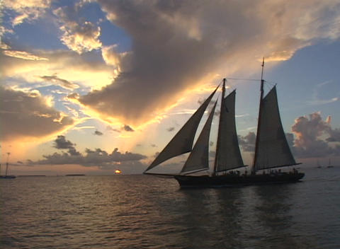 A sailboat cruises across the water Stock Video Footage