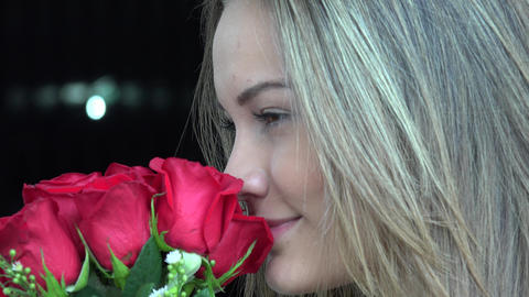 Woman Smelling Flowers Footage