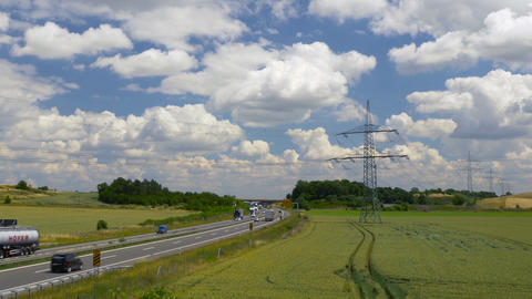 Highway in sunny landscape. Transport in Germany, Europe Live Action