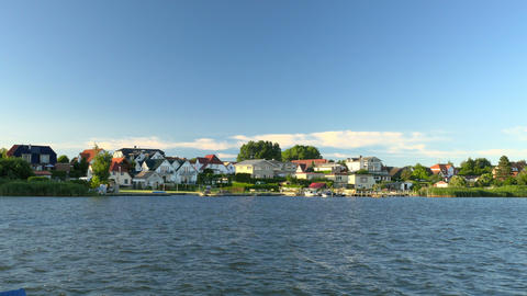 Beautiful lake scenery with houses in sunlight. Europe, Germany Footage