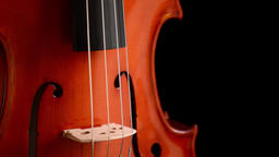 Violin or viola gyrating at black background Footage