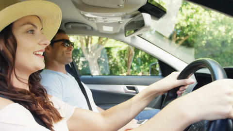 Couple together in a car on road trip Live Action