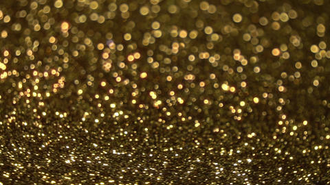 Slowly Rotating Sparkling Golden Glitter Bokeh Animation