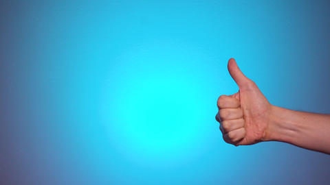 Man showing thumbs up gesture GOOD with blank space Live Action
