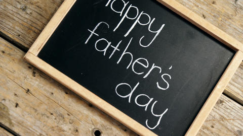 Happy fathers day message written on slate Live Action