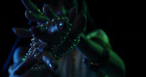 Portrait of Saraswati an indian goddess with pearl beads in her hands, 4k Live Action