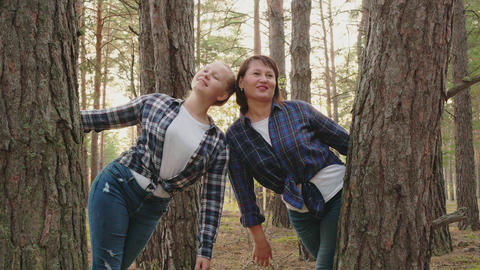 Beautiful smiling playful women in scenic forest Stock Video Footage