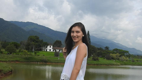 Happy Teen Girl In Countryside Near Mountains Footage