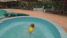 Little Girl Jumps into Pool by Toy Crocodile at Hotel Footage