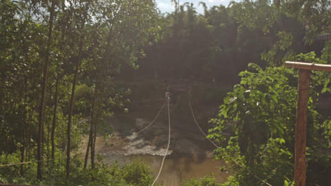 View of Zipline Attraction with Person in Tropical Park Footage