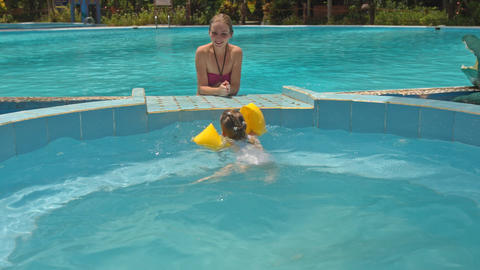 Little Girl Jumps into Pool Mother Looks at Hotel Footage