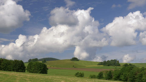 Timelapse clouds over green hills. Europe, Germany Footage