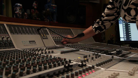 Recording music studio engineer mixing board sound desk in recording studio Live Action