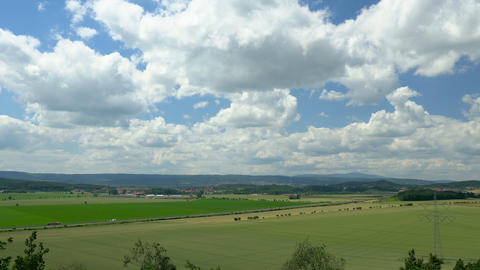 Timelapse clouds over green landscape. Europe, Germany Footage