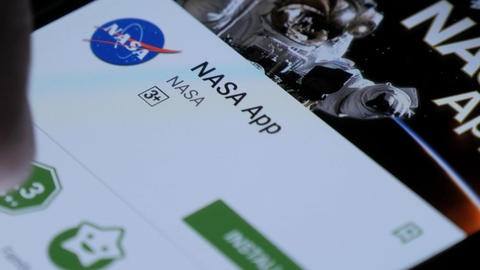 NASA app in the mobile application store smart phone Live Action