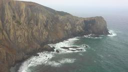 Ocean Waves Hit Cliffs During Fog Live Action