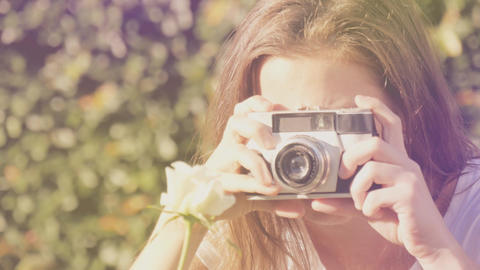 Girl with retro camera taking photos and practicing photography in outdoors Footage
