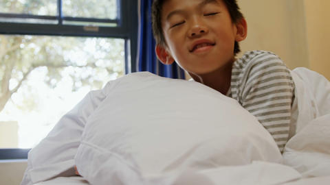 Boy sleeping on the bed in bed room 4k Live Action