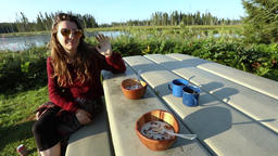 Outdoor breakfast table setting by river Live Action