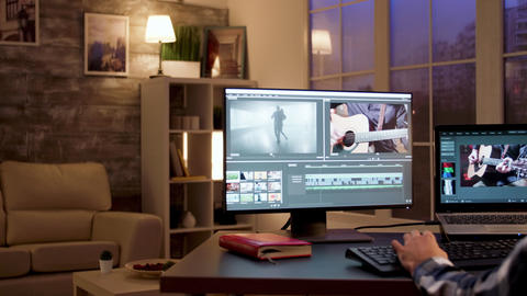 Back view of content creator using modern software for post production Live Action