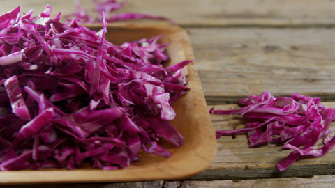 Shredded cabbage in wooden bowl 4k Live Action