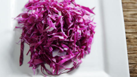 Shredded cabbage in plate 4k Live Action