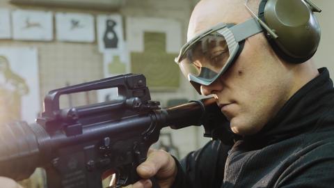 Man trains to shoot at the shooting range, closeup Live Action