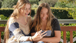 Gen Z bff teenage girls with mobile smartphone technology taking funny selfie Footage