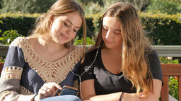 Happy best friend teenage girls listening to music together lifestyle friendship Footage