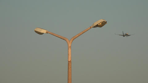 Street Lamp And Airplane Footage