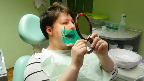 Woman Looking At Mirror In The Dentists Chair 4k Footage